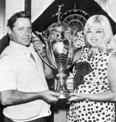 Peter collects the 1973/74 News of the World Individual Darts trophy from film star and entertainer Diana Dors (Photo: News of the World)