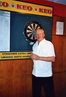 Patrick in the Wembley pub, Limassol, looking for a game of darts